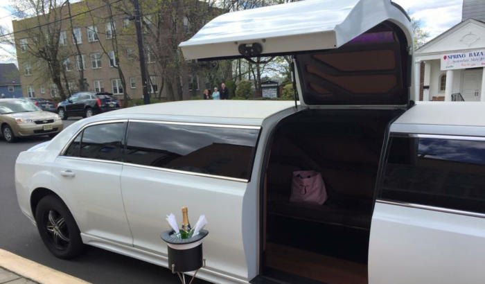 Vehicle 1. 12 Passenger Chrysler Limousine With Jet Door 2