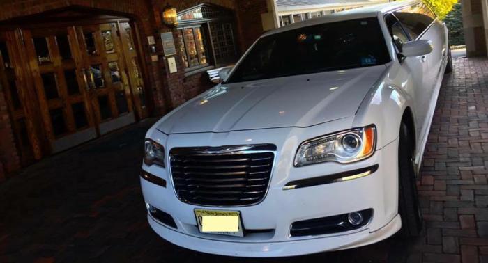 Vehicle 1. 12 Passenger Chrysler Limousine With Jet Door 3